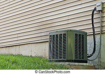 Residential Central Air Conditioner Unit - A residential...