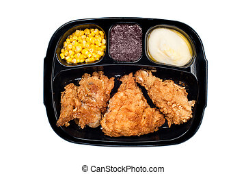 Chicken TV dinner in plastic tray - A cooked tv dinner of...