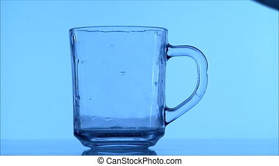 glass of water - glass of sparkling water in blue color