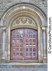 old and acient wooden doors entrance and stone