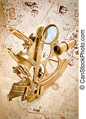 Antique polished brass sextant over old Navigation Chart...