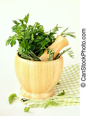 herbs in wooden mortar with pestle