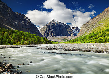 Mountain landscape - Mountain valley with river and green...