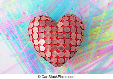 heart - A red heart with 1 Euro cent coins and drinking...