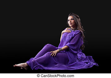 Young girl lay in purple traditional costume