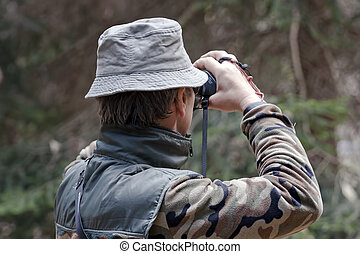 man checking target before shooting with a technological bow...