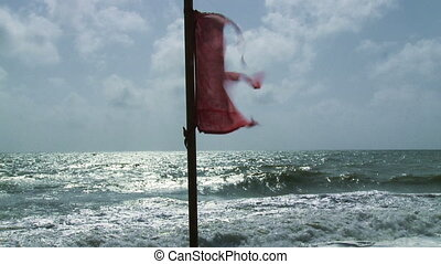 Beach Warning Flags - Warning flag at the beach, with rough...