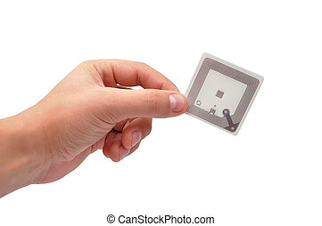 RFID tag in hand  on a white background