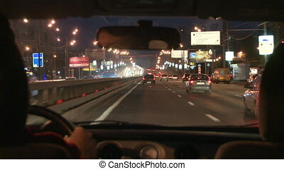 City driving - HD1080p: Time lapse of a car driving in the...