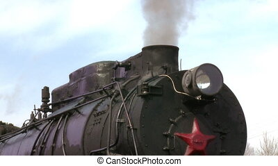 old train with steam engine closeup - Close up detail of a...