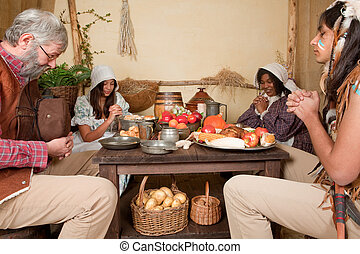 Thanksgiving family giving thanks - Reenactment scene of the...