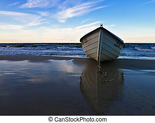 A boat on shore of the Baltic Sea.