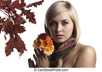 cute and pretty blonde wearing a scarf and holding some...