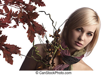 portrait of a cute and natural blonde with autumn flowers