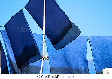 Scarves drying in the sun - Blue dyed scarves drying in the...