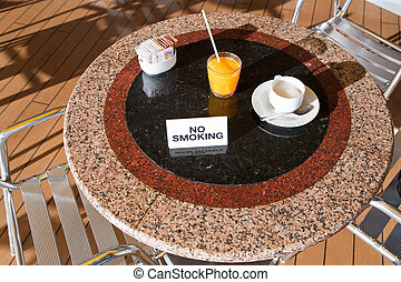 fresh orange juice and cappuccino on no smoking table