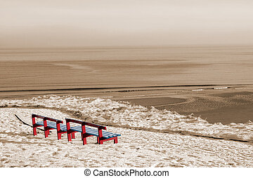 winter beach view and red benches