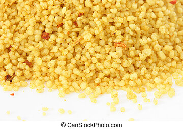 Brown bowl with couscous on white background - Close up view...