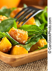 Baked pumpkin, spinach and sesame salad