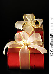 Red foil gifts - Two red foil gifts with golden bows on...