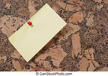 paper clip and push pin on cork noticeboard