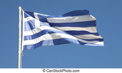 Greek flag - Greek flag waving in wind against clear blue...