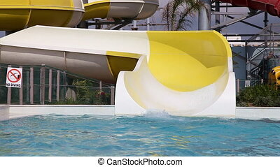 Waterpark fun   - Senior couple Having Fun On Water Slide