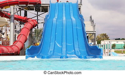 Water park   - Sliding down on water slide in waterpark
