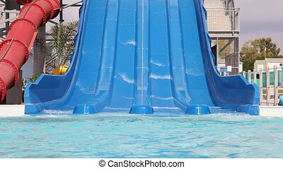 Water slide - Grandpa with granddaughter sliding on water...