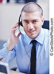 businessman with a headset portrait at bright call center...