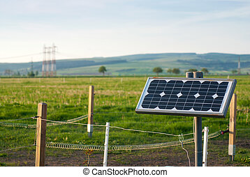 Solar energy panel with electric fence on a farm