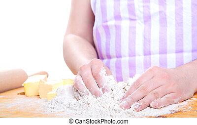 female hands in flour closeup kneading dough