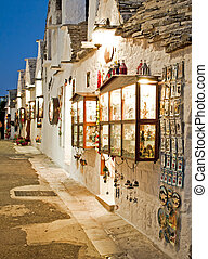 Souvenir shop entrance at night in Alberobello Italy