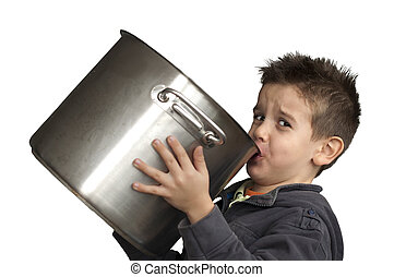 Child drinking milk from a big saucepan - Child drinking...