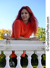 Redhead girl standing at the railing