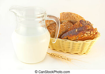 Slices of bread and milk on a white background