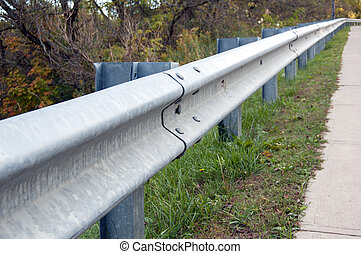 standard guardrail Traffic barriers keep vehicles within...