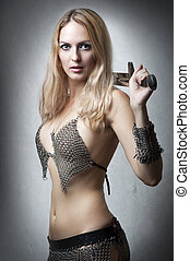 Portrait of young sexy model Woman warrior with sword in...