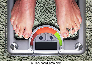 Woman on the weight scale - Bathroom scales isolated against...