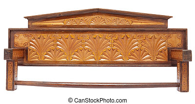 Old carved wooden ktichen towel rack with woodworm holes