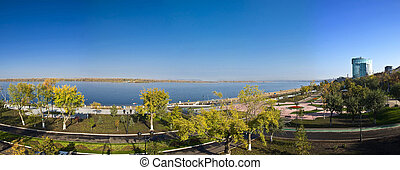 Panorama of a large city on the banks of the river. Quay. Samara, Russia. Autumn Landscape.