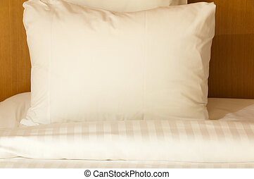 White pillow and blanket on a hotel bad