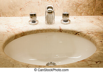 Faucet with handles and white sink - Faucet with two handles...