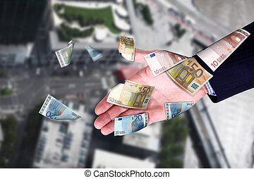 Cityscape and hands holding banknotes
