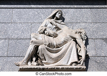 Pieta - Milan, Italy. Old grave pieta scene sculpture at the...