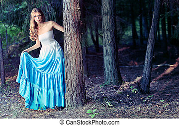 forest - Romantic young woman posing outdoor