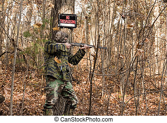 illegal hunter - man hunting illegally on posted land