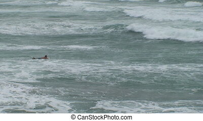 Surfing Wide Shot - A wide shot from above of two surfers...