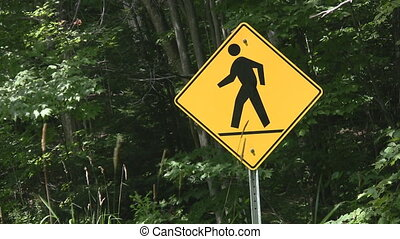 Pedestrian sign. - A sign warns to look out for pedestrians...