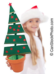 Christmas tree decoration in litte girl hand - Christmas...